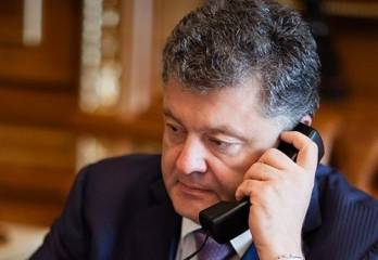 Poroshenko urges Putin to free detained people, intensify work in Normandy format