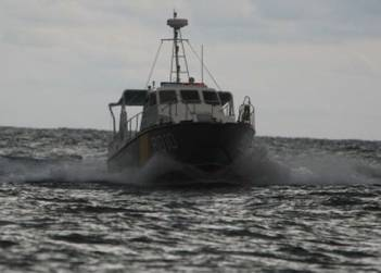 Ukrainian border guards arrest fishing vessel flying Russian flag in Azov Sea