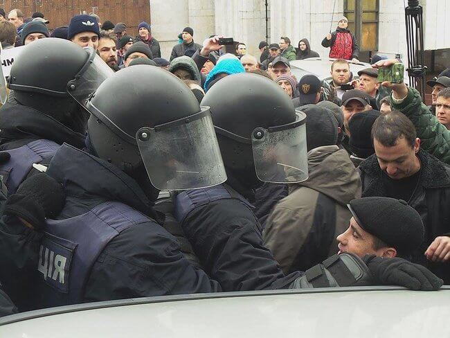 Thirteen people, including 11 policemen, injured in clash at tent camp near Rada in Kyiv
