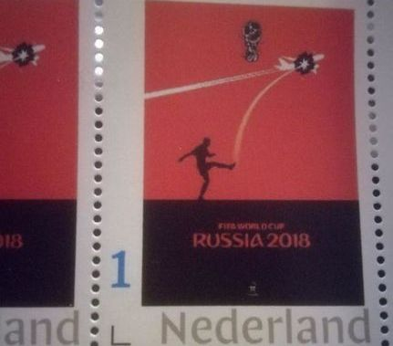 Stamp with football player knocking down flight MH17 printed in Netherlands - media
