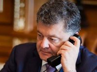 Poroshenko calls on Merkel to support toughening of sanctions against Russia in response to 'passport decrees'