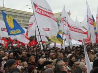 Demonstrators leave government district in central Kyiv