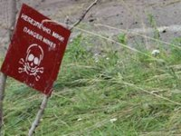Over 100 pyrotechnic experts demining four villages near Chernihiv region ammo depot