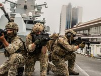 Ukrainian, British and U.S. commandos conduct joint training session on military destroyer Defender
